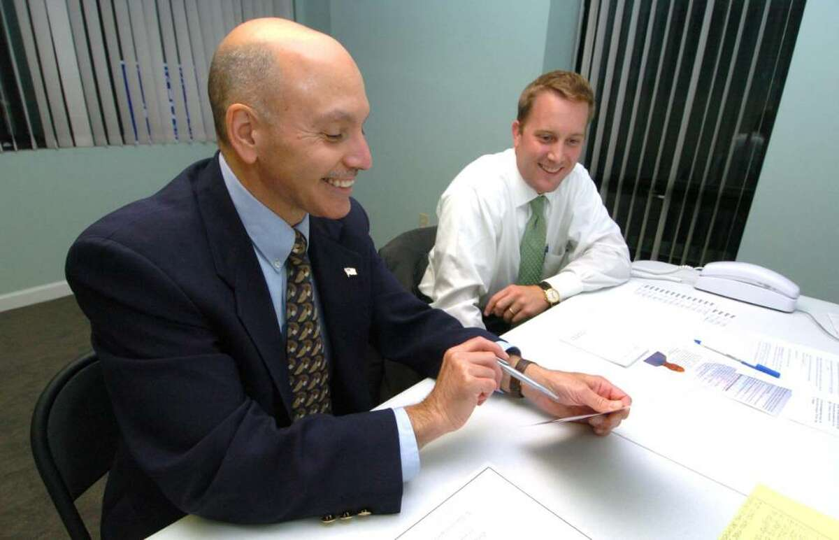 From left, Gary Goncalves and Ryan Reynolds work on the democratic campaign for mayor of Danbury, Wednesday, Oct. 7, 2009.