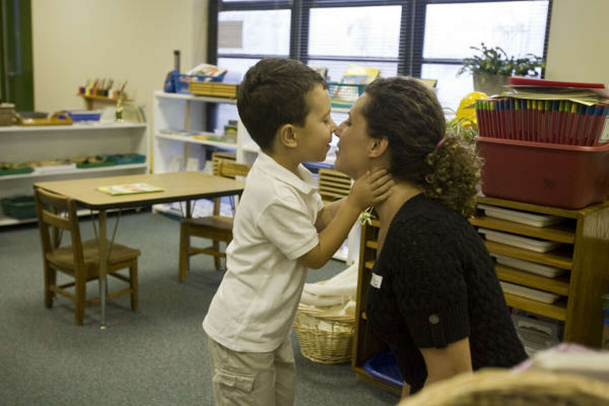Five-year-old Ege Karabilecen embraces his mother Ebru Erdini on the first day of school at HISD's Garden Oaks Elementary School.