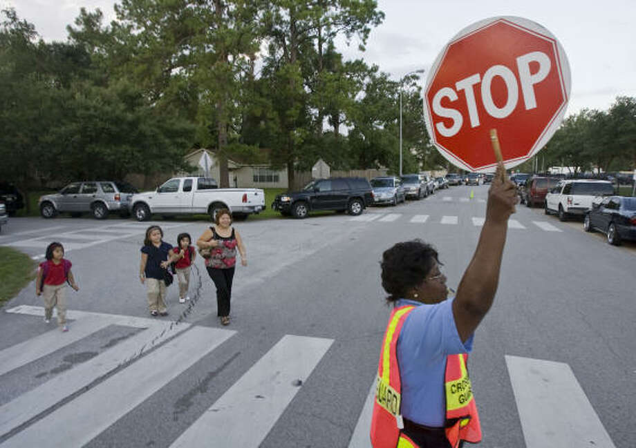 Crossing guard Alice Campbell works outside Garden Oaks Elementary. Photo: James Nielsen, Chronicle