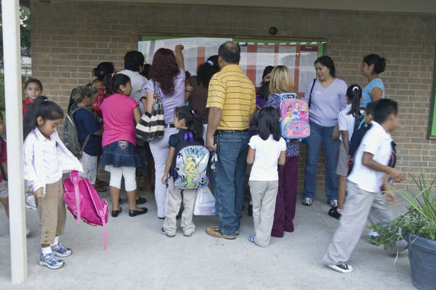 Parents and students arrive at Garden Oaks Elementary.