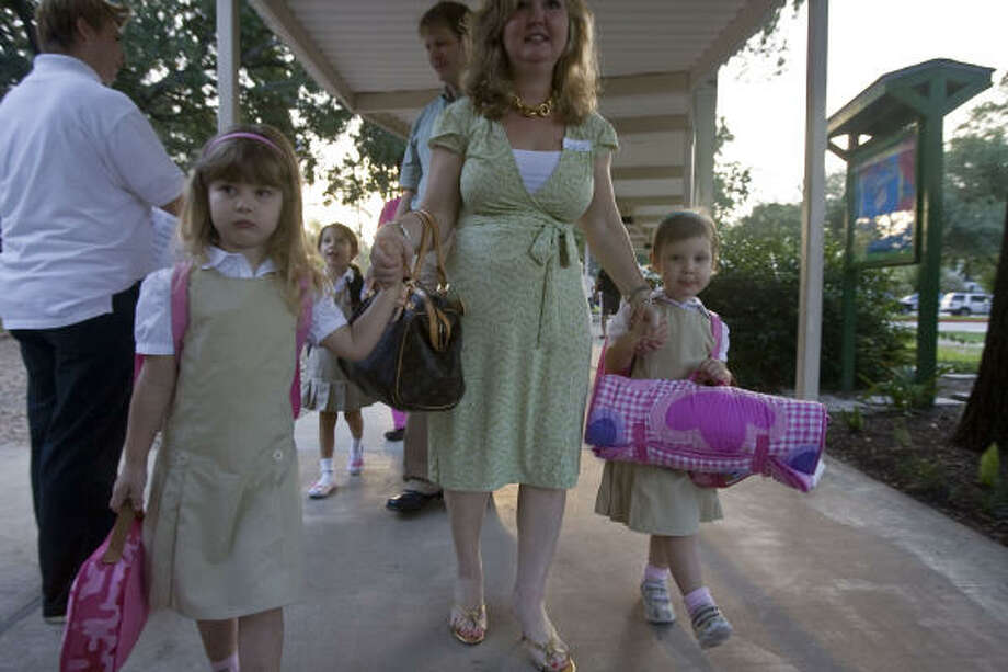 Ella Sailors (left) arrives for class at Garden Oaks. Photo: James Nielsen, Chronicle