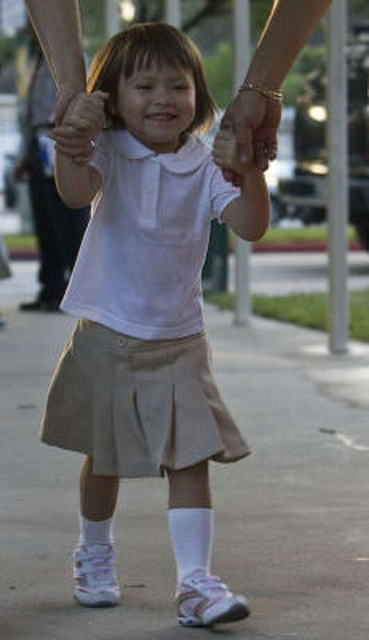 Three-year-old Lily Shade arrives at Garden Oaks Elementary. Photo: James Nielsen, Chronicle