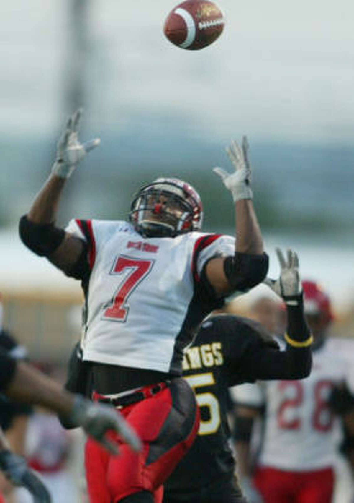2003 North Shore linebacker Courtney Lane, top, picks off a pass in front of Hastings tailback Josh Albert.
