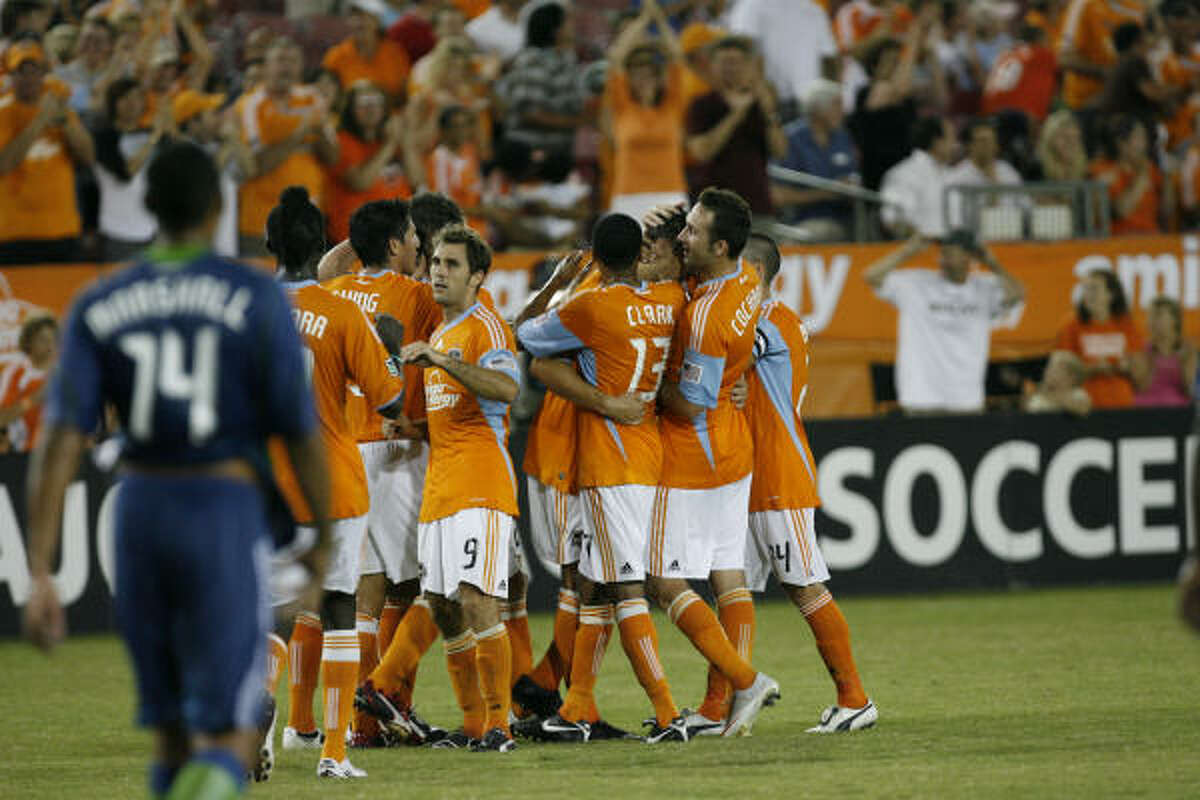 Dynamo players celebrate the goal scored by Geoff Cameron, his first of the season, in the first half.