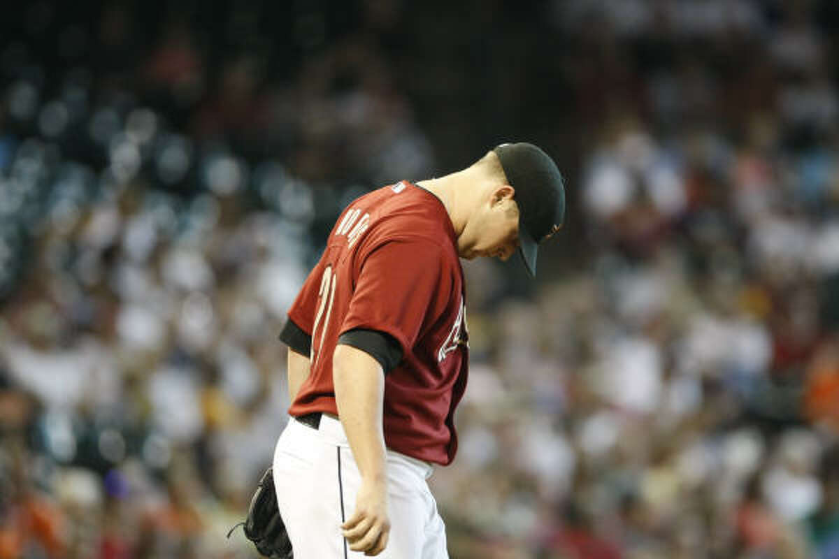 Astros starting pitcher Bud Norris is roughed up in the first inning as he gives up five runs.