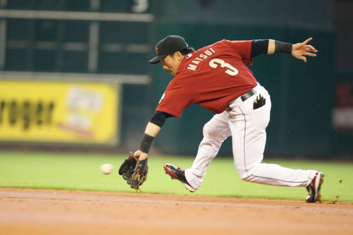 Astros second baseman Kazuo Matsui tries to make a play at first in the second inning.