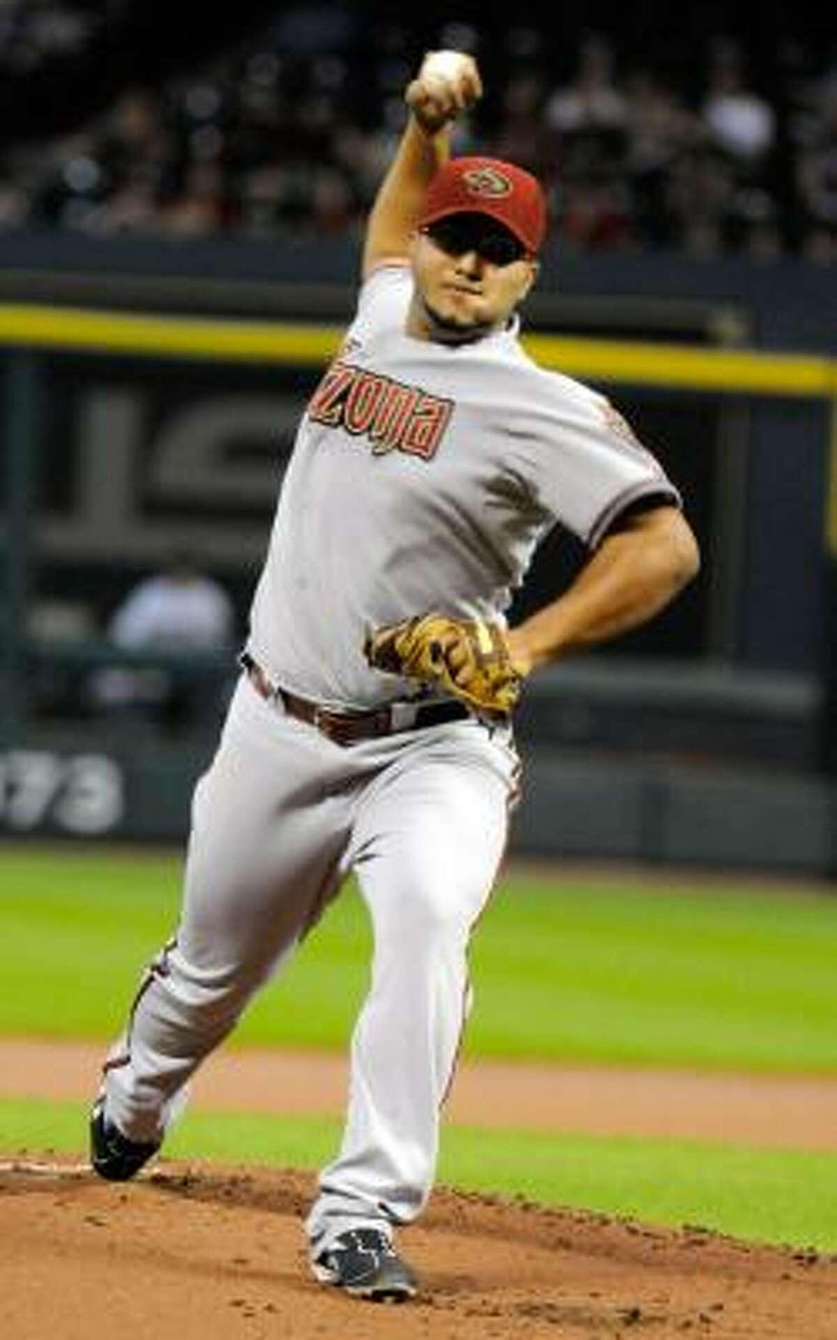 Diamondbacks' Yusmeiro Petit delivers a pitch against the Astros.