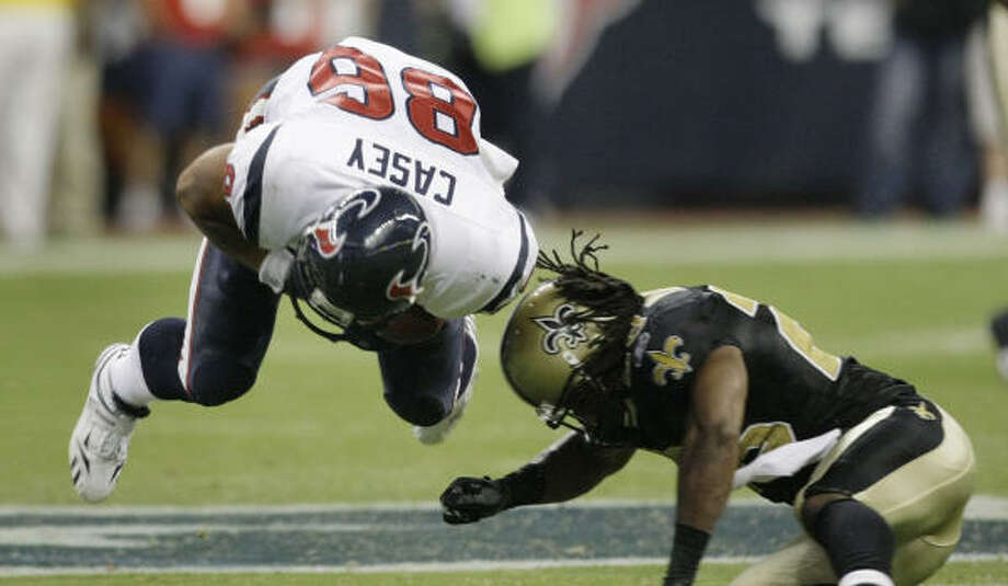 Texans tight end James Casey is hit by New Orleans cornerback Usama Young during the third quarter. The Texans lost to the Saints 38-14. Photo: Brett Coomer, Chronicle