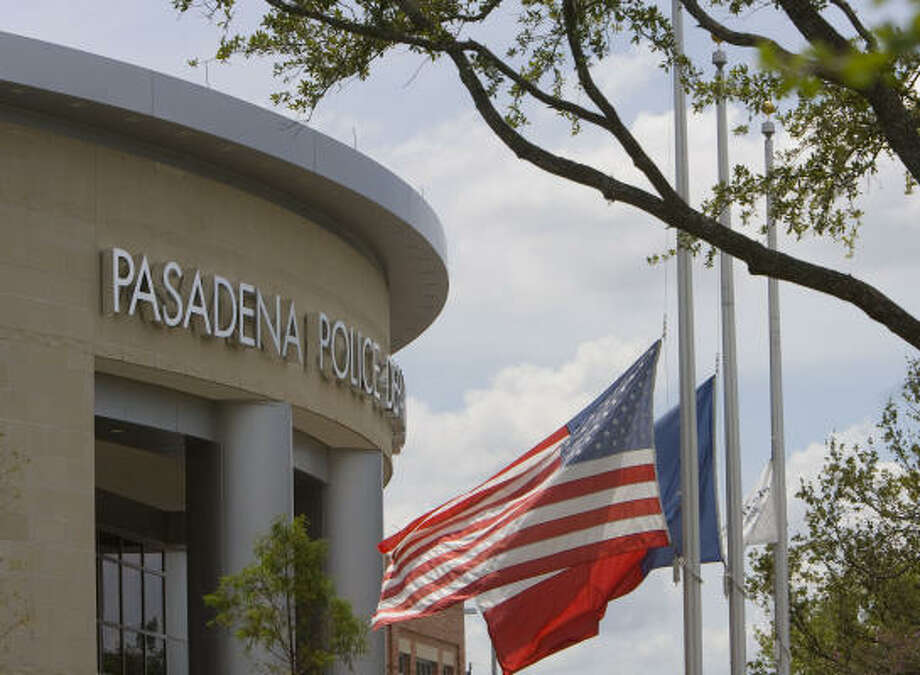 Flags fly at half-staff at the Pasadena Police Station. Photo: James Nielsen, Chronicle