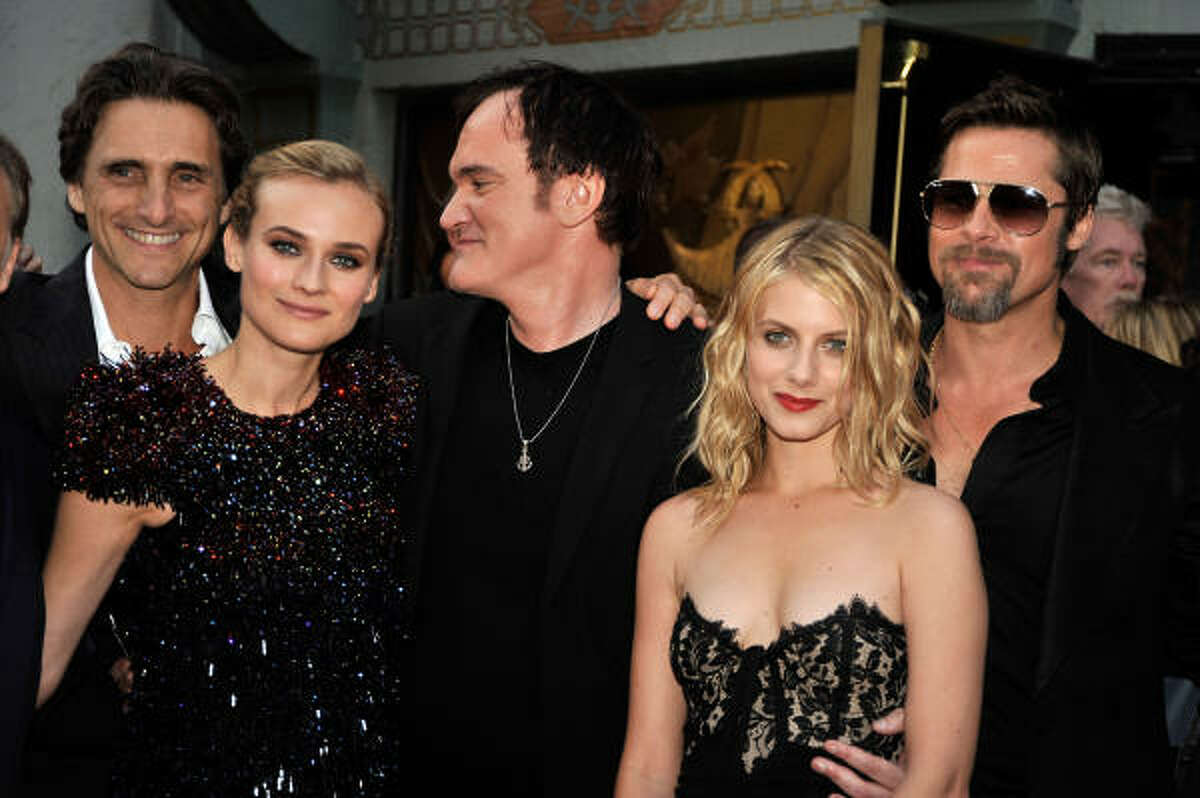 Producer Lawrence Bender, actress Diane Kruger, director/writer Quentin Tarantino, actress Melanie Laurent, and actor Brad Pitt arrive at the premiere of Weinstein Co.'s