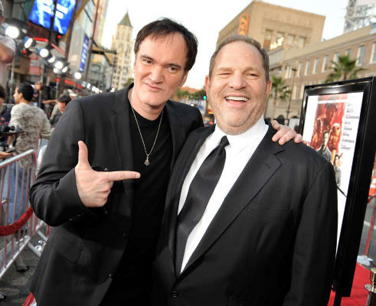 Director Quentin Tarantino and producer Harvey Weinstein arrive at the premiere of Weinstein Co.'s