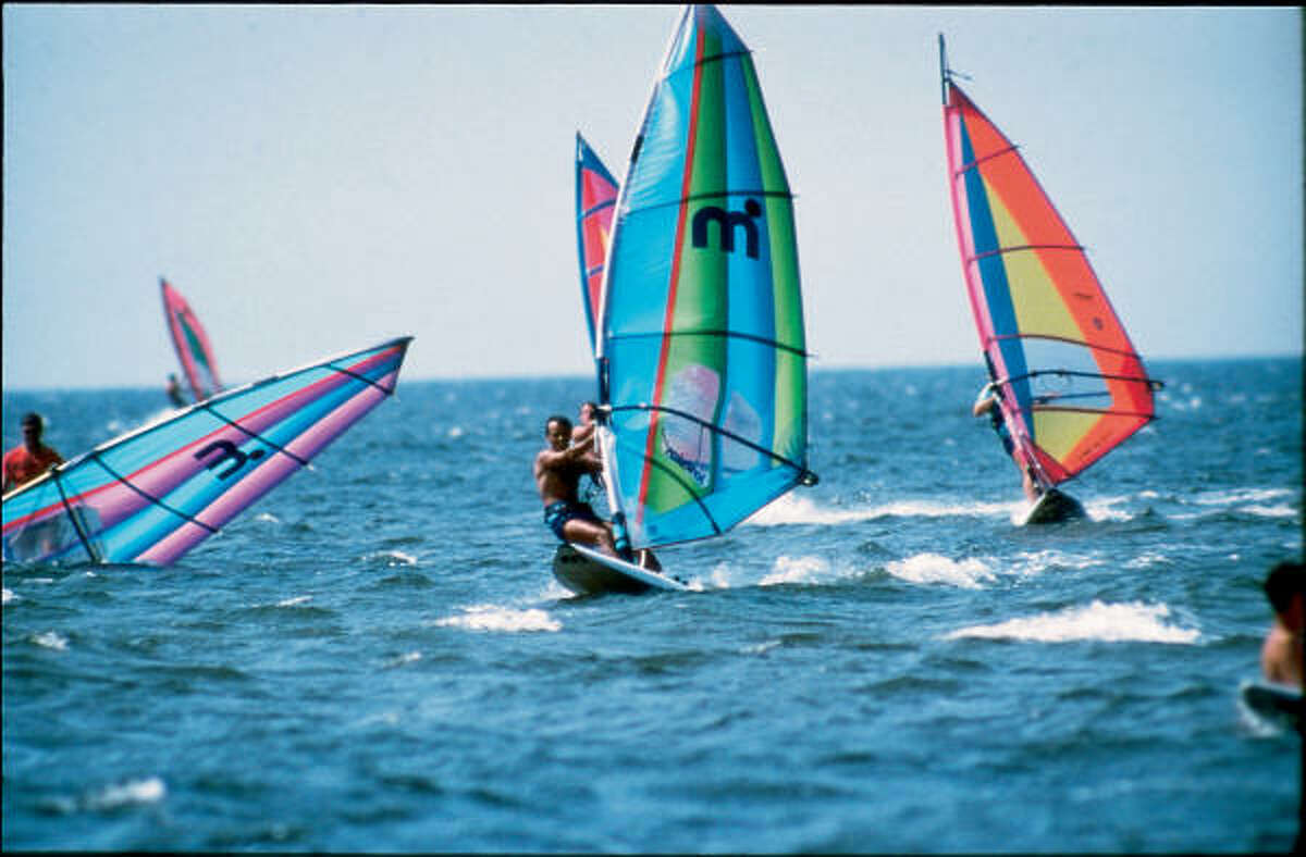 Windsurfing is just one of the popular watersports visitors can dive into on the Outer Banks.