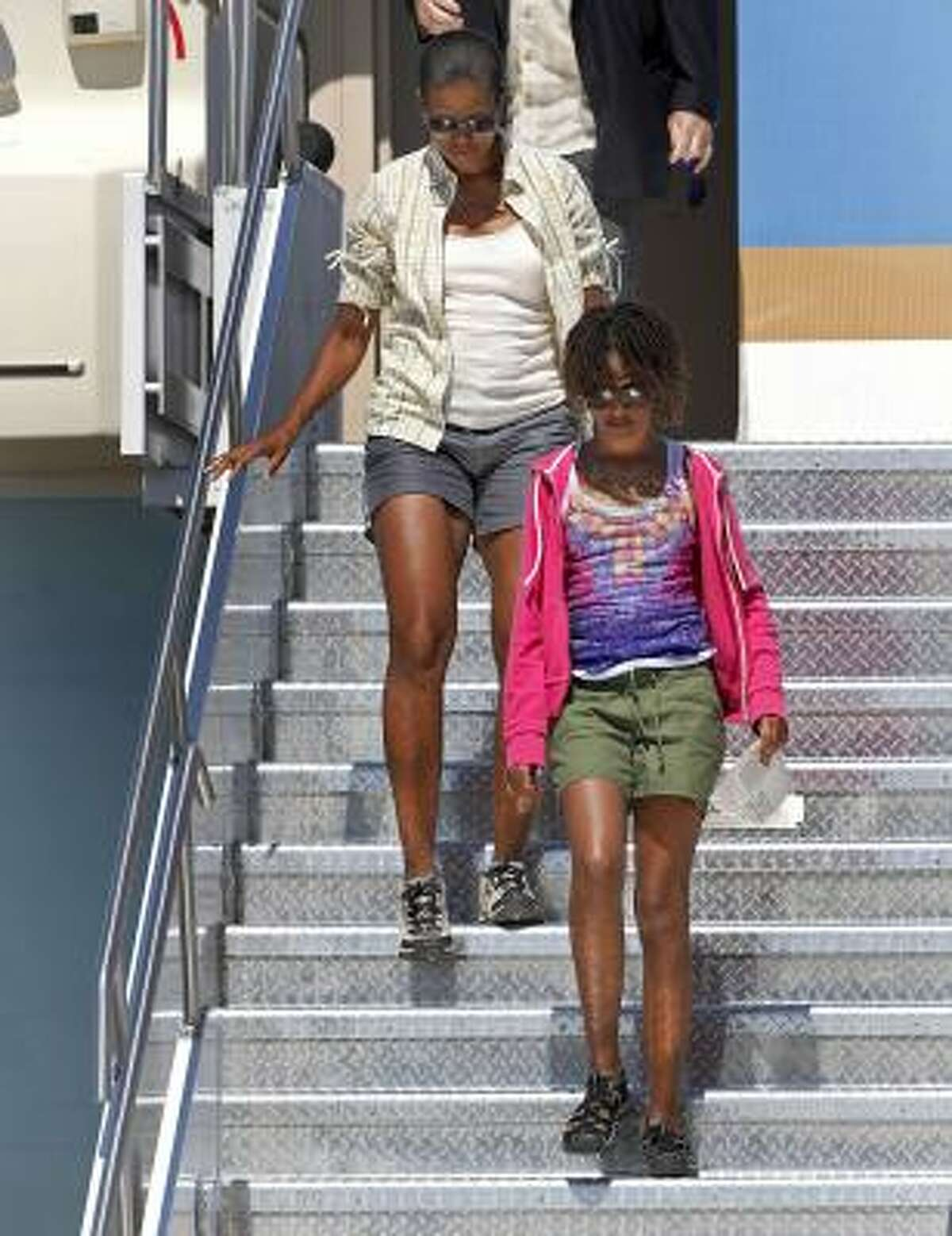 Are shorts an inappropriate fashion choice for the first lady? Michelle Obama walks down the stairs of Air Force One with her daughter Malia on a trip to the Grand Canyon recently.
