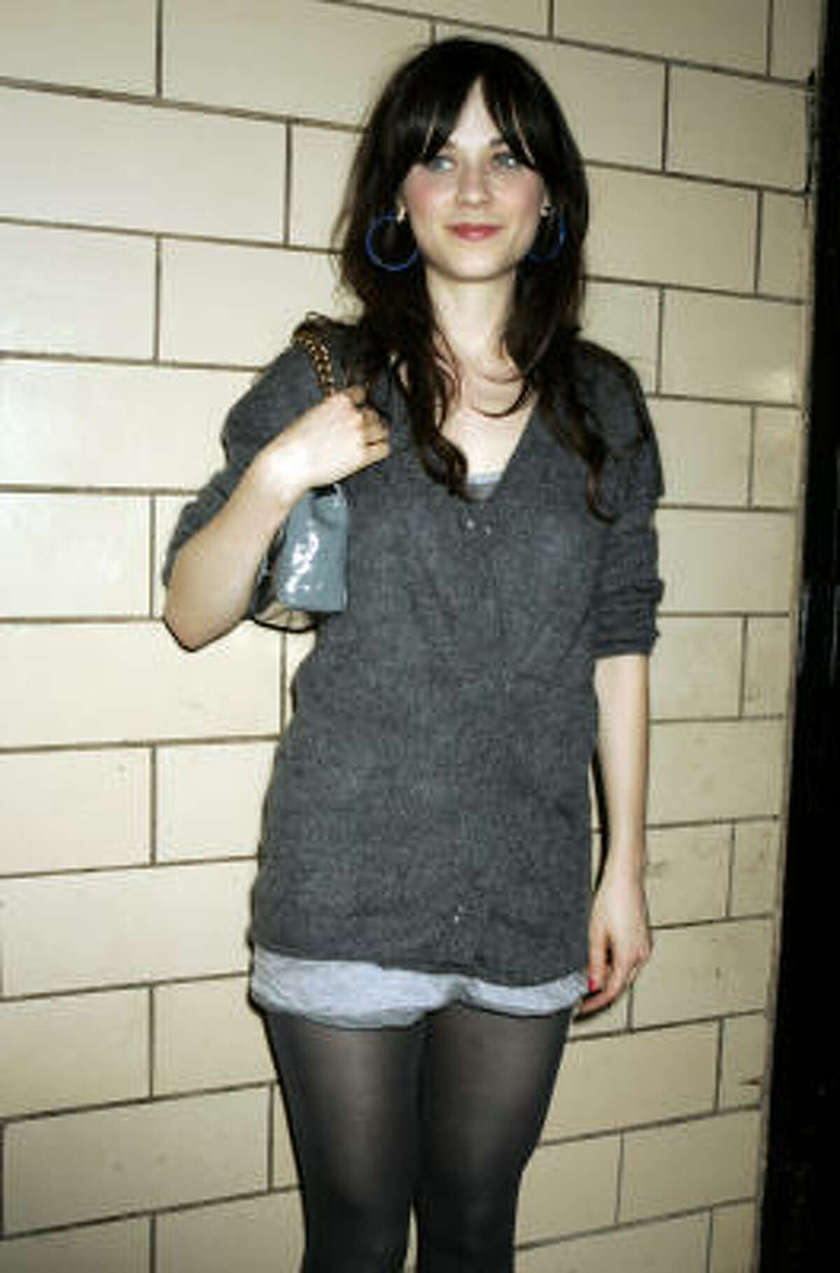 Actress Zooey Deschanel is known for her classic style. Although some find it an odd statement, it has become popular to wear shorts with leggings in cooler months.