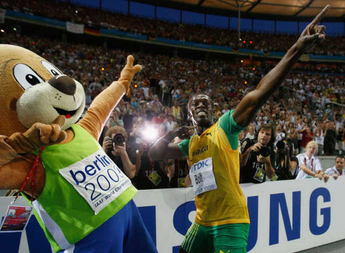 Usain Bolt of Jamaica celebrates winning the gold medal in the men's 200 meters final during day six of the 12th IAAF World Athletics Championships at the Olympic Stadium in Berlin.