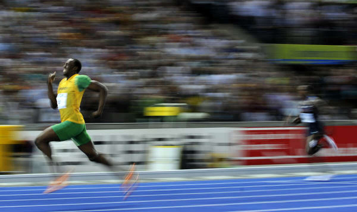 Usain Bolt destroys the competition. Alonso Edward of Panama was second, a distant 0.62 seconds behind.