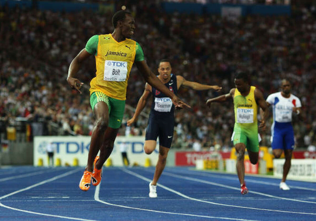 Usain Bolt of Jamaica crosses the line to win the gold medal in the 200 meters.