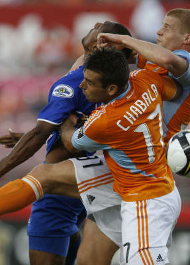 Aug. 19: Dynamo 1, A.D. Isidro Metapan 0A.D. Isidro Metapan's Anel Alejandro Canales, left, goes up for the ball against Dynamo defenders Mike Chabala (17) and Andrew Hainault. Photo: Julio Cortez, Chronicle