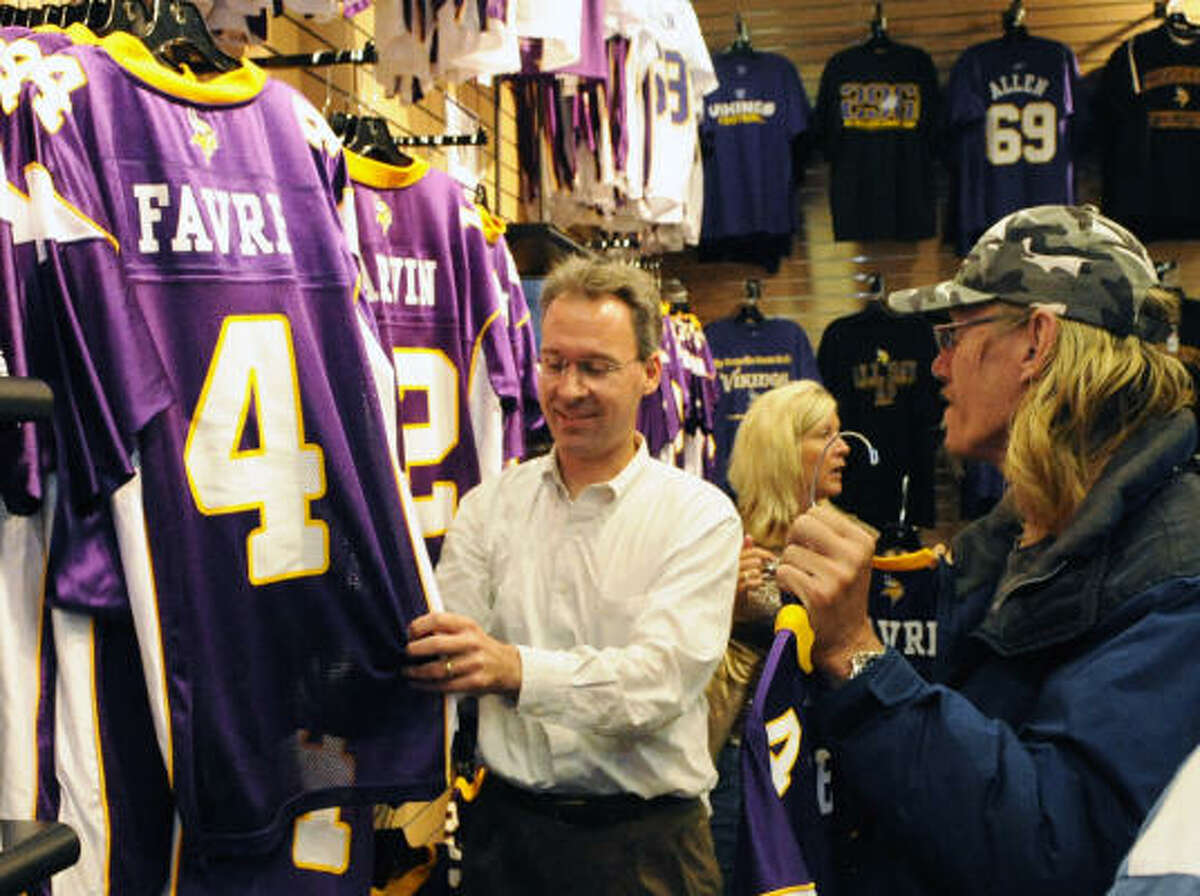 Ted Herzog, left, of Minneapolis and Carl Brunsky of New Hope, Minn., look at the new Minnesota Vikings' Brett Favre (4) replica jerseys on sale at the Vikings Locker Room store at the Ridgedale Shopping Center in Minnetonka, Minn., on Wednesday.