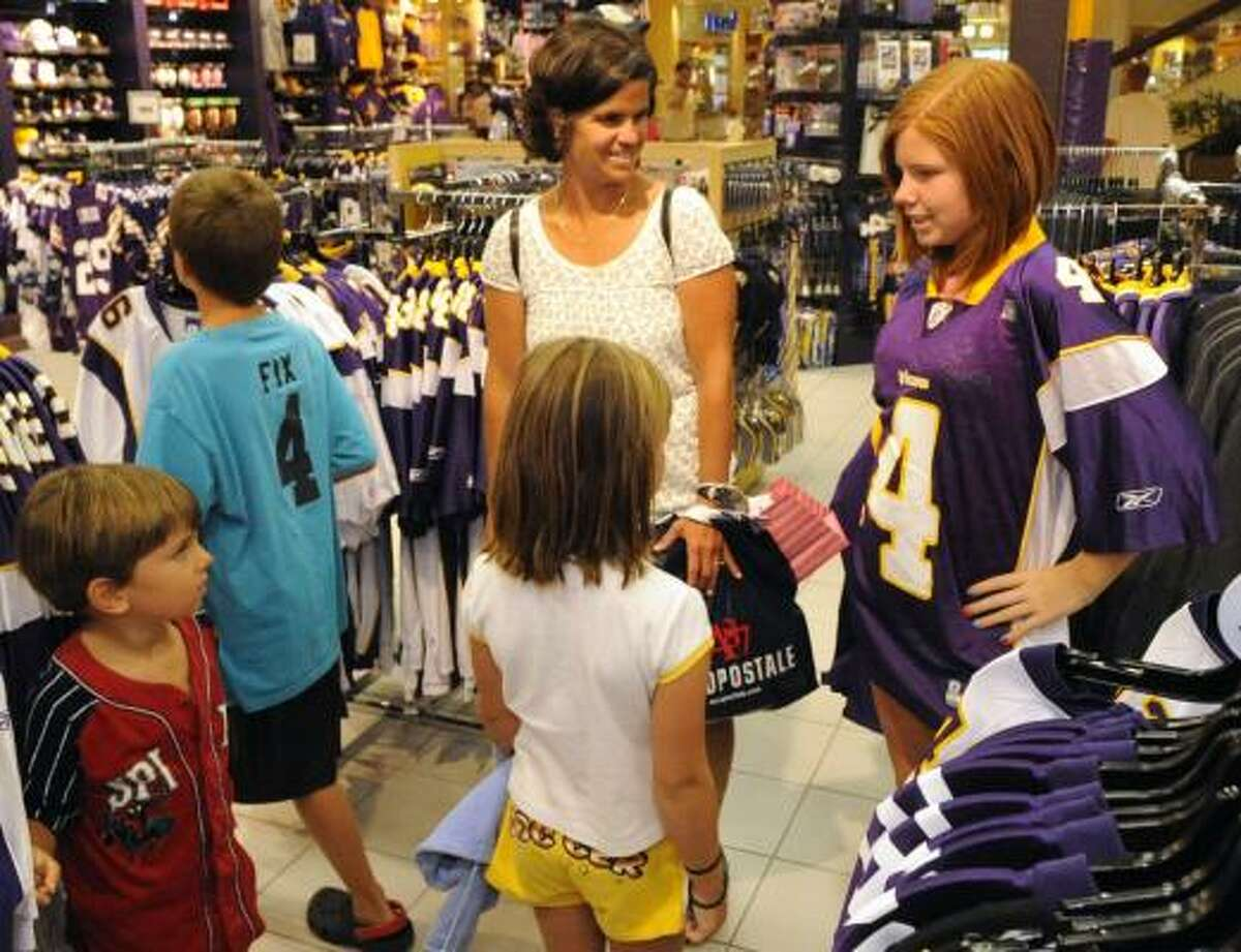 Greta Fix, 12, models a Minnesota Vikings' Brett Favre replica jersey to her mother, Susan Fix and siblings at the Vikings Locker Room store at the Ridgedale Shopping Center.