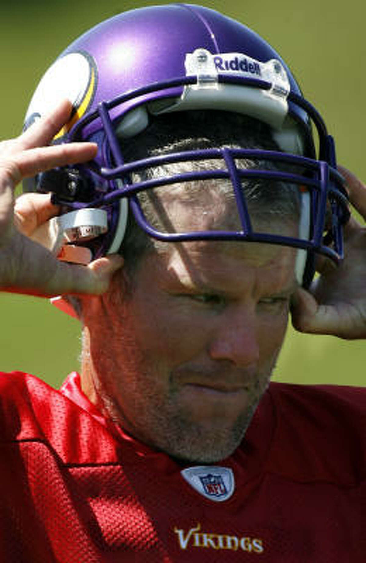 New Minnesota Vikings quarterback Brett Favre looks on during NFL football training camp Tuesday, Aug. 18, 2009, in Eden Prairie, Minn. (AP Photo/Star Tribune, David Joles) ** ST. PAUL OUT, MINNEAPOLIS-AREA TV OUT m MAGS OUT **