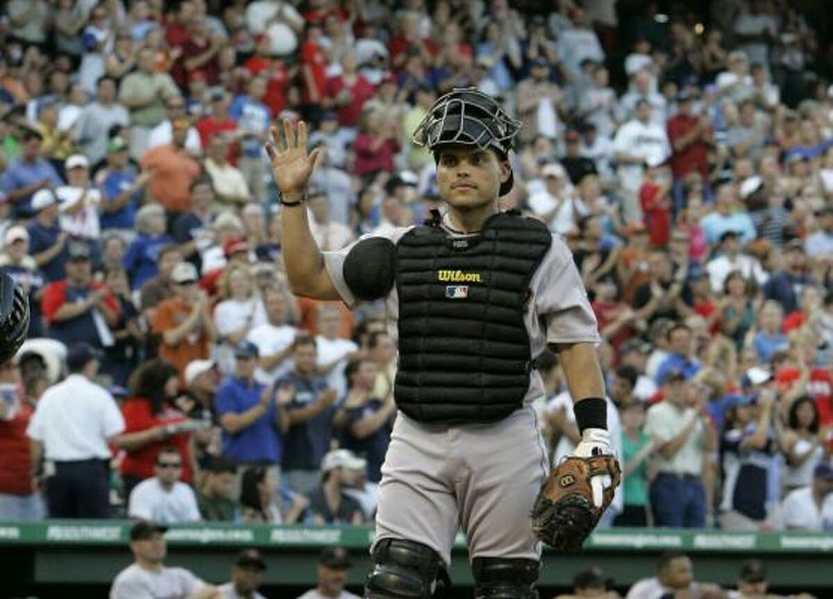 Astros catcher Ivan Rodriguez acknowledges cheers from fans after a video tribute was played during the third inning against the Rangers. Rodriguez passed Carlton Fisk for the major league record for games played by a catcher.