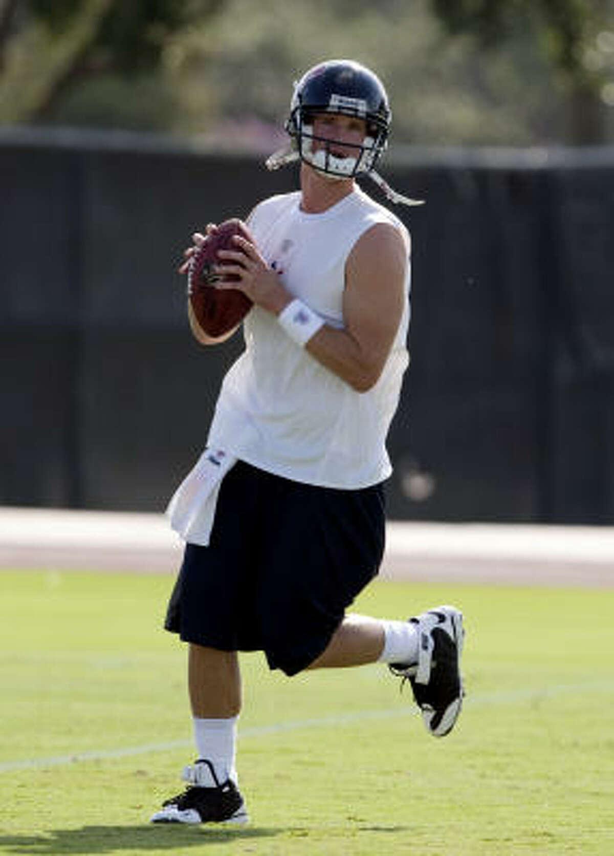 Quarterback Alex Brink runs through drills during Texans' football practice.