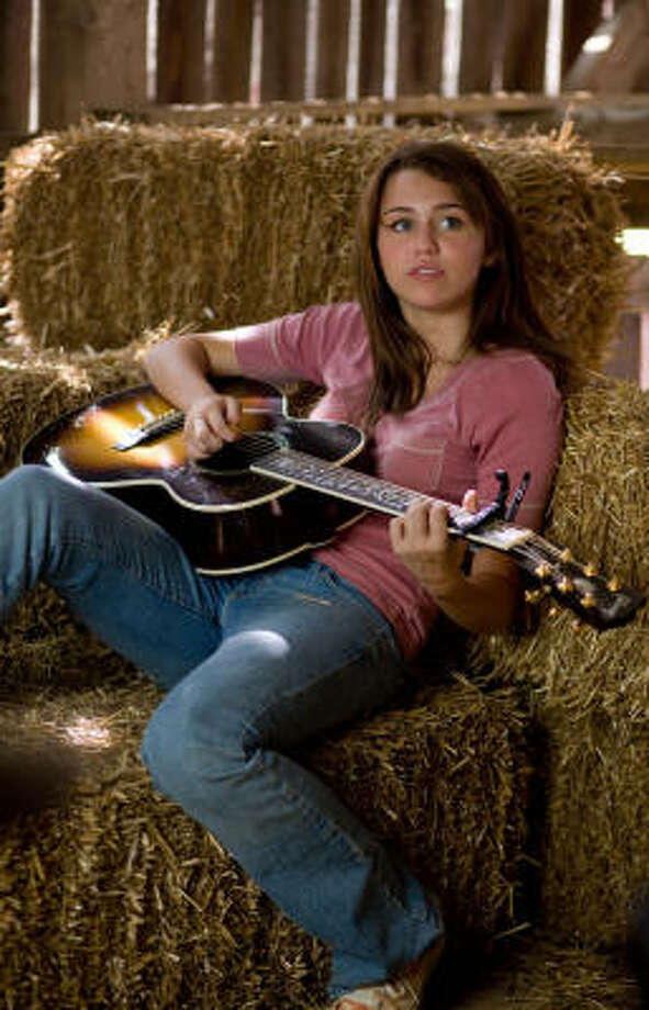 "In 2009, Miley Cyrus tried to go back to her roots in ""Hannah Montana: The movie."" Photo: Photo: Sam Emerson"