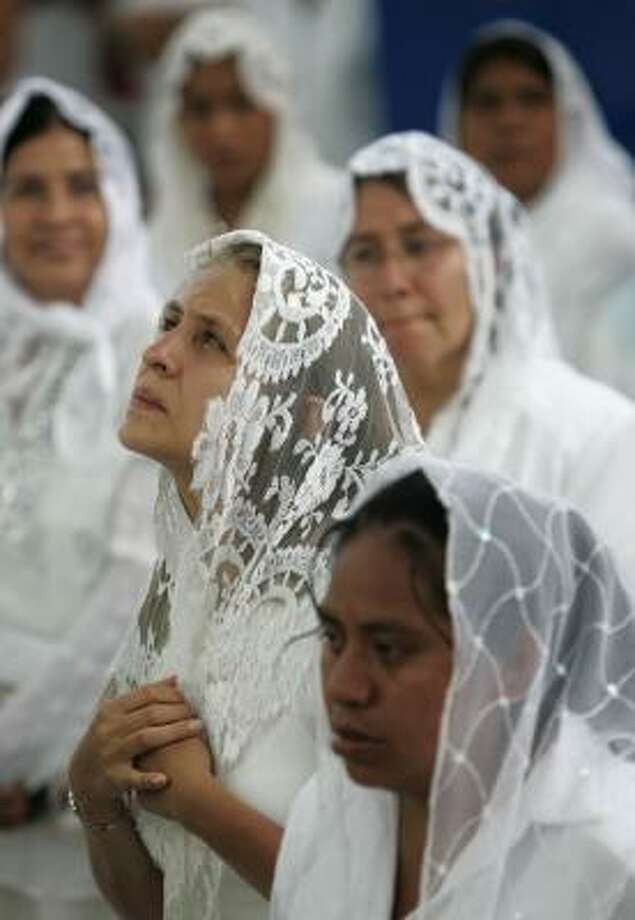 A worshipper prays among the congregation. Post your photos of faith | HoustonBelief.com Photo: Carlos Jasso, AP