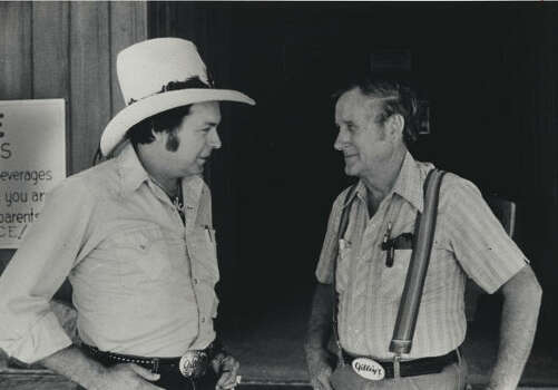 Mickey Gilley, left, handled the singing and Sherwood Cryer ran Gilley's when this photo was taken at the Pasadena club in 1980. Photo: Joel Draut, Houston Chronicle