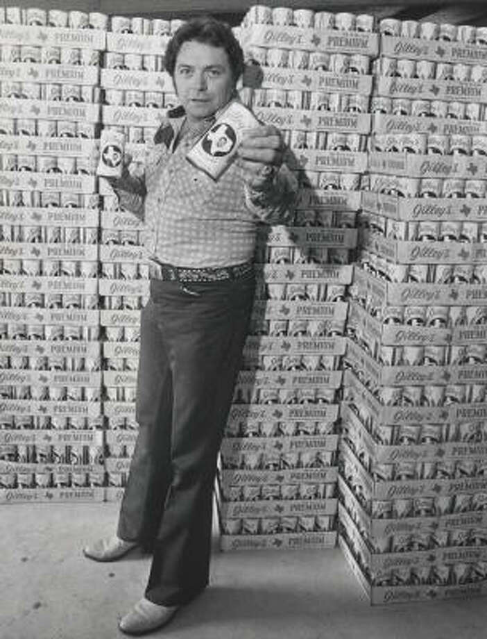Honky-tonk legend Mickey Gilley touts Gilley's Beer in 1979. Photo: Houston Chronicle File