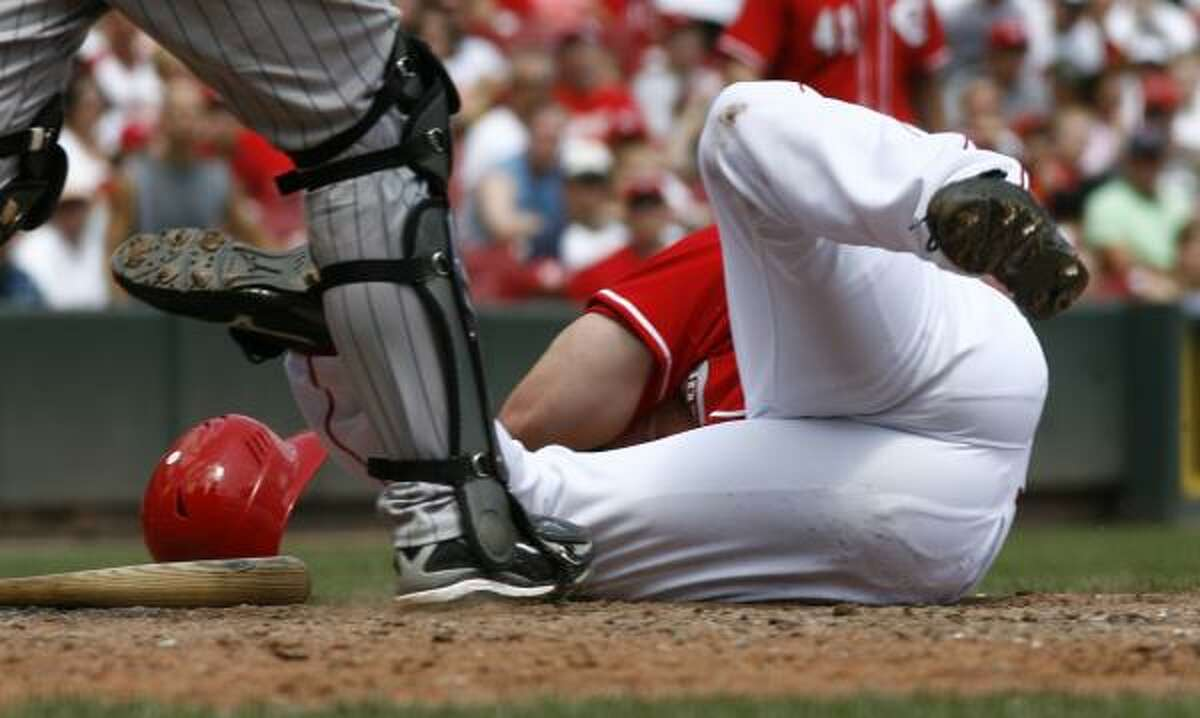 August 2 Cincinnati Reds' Scott Rolen falls to the ground after being hit by a pitch from Colorado Rockies pitcher Jason Marquis.