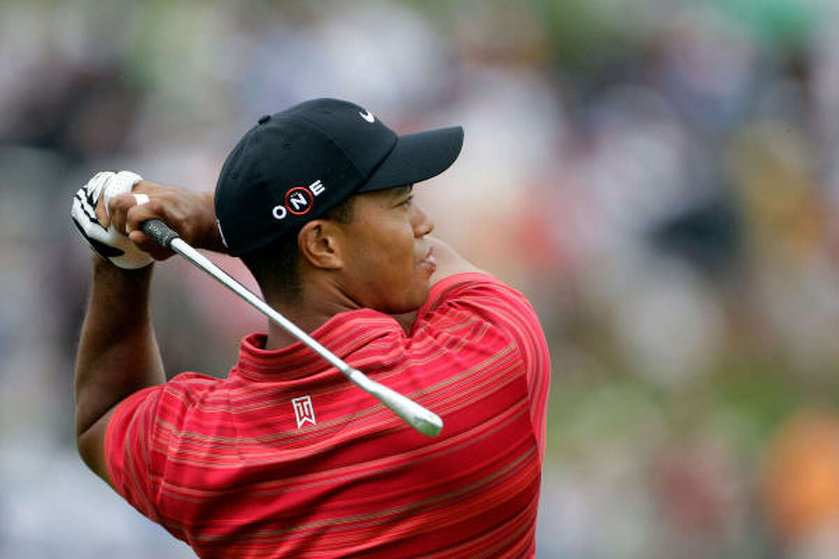 Tiger Woods hits a shot on the practice ground before the final of the 91st PGA Championship at Hazeltine National Golf Club.