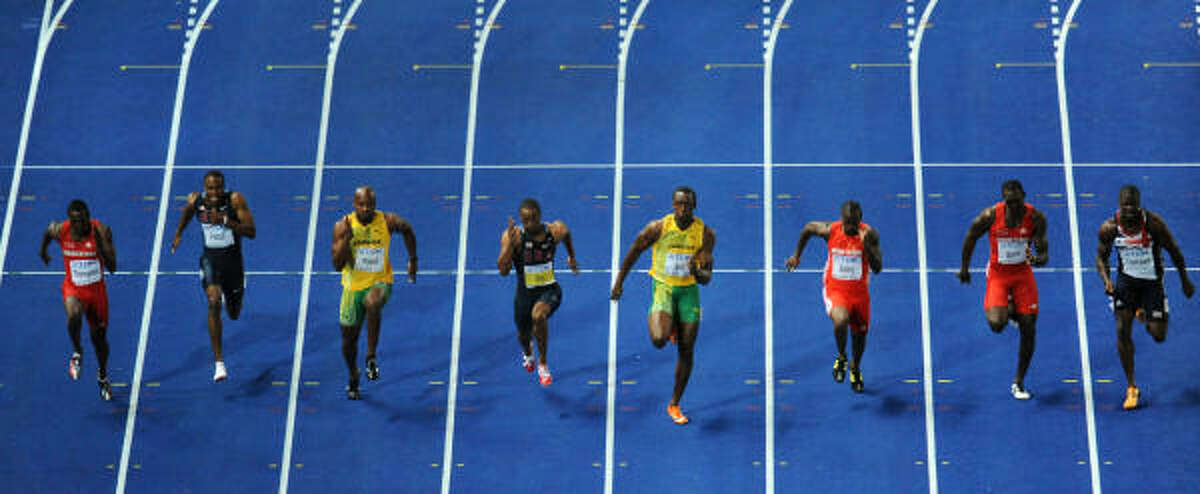 From left, Trinidad and Tobago's Richard Thompson, U.S.'s Darvis Patton, Jamaica's Asafa Powell, U.S.'s Tyson Gay, Jamaica's Usain Bolt, Antigua and Barbuda's Daniel Bailey, Trinidad and Tobago's Marc Burns and Great Britain's Dwain Chambers compete in the men's 100m final race of the 2009 IAAF Athletics World Championships.