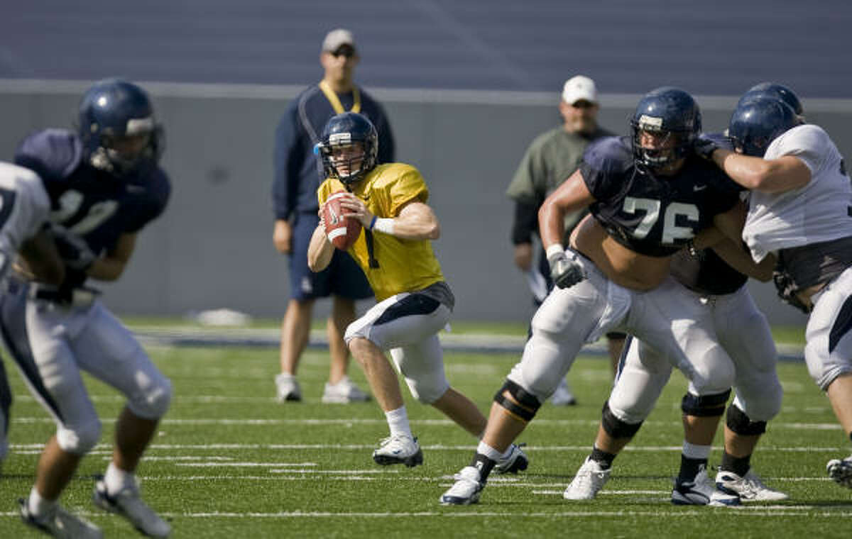 Rice quarterback John Thomas Shepherd, center, throws a pass during the team's first scrimmage Saturday at Rice Stadium. Shepherd is one of three QBs battling for the starting job, along with Ryan Lewis and Nick Fanuzzi.