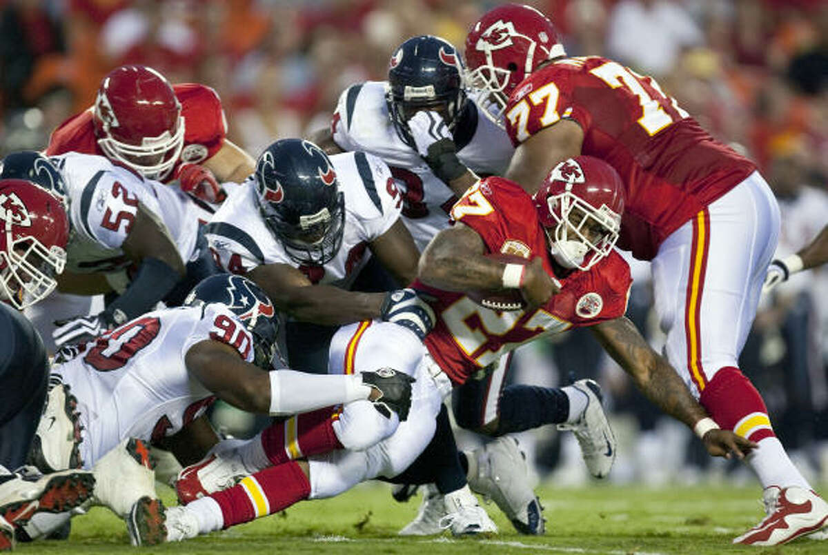 Chiefs running back Larry Johnson tries for extra yardage.