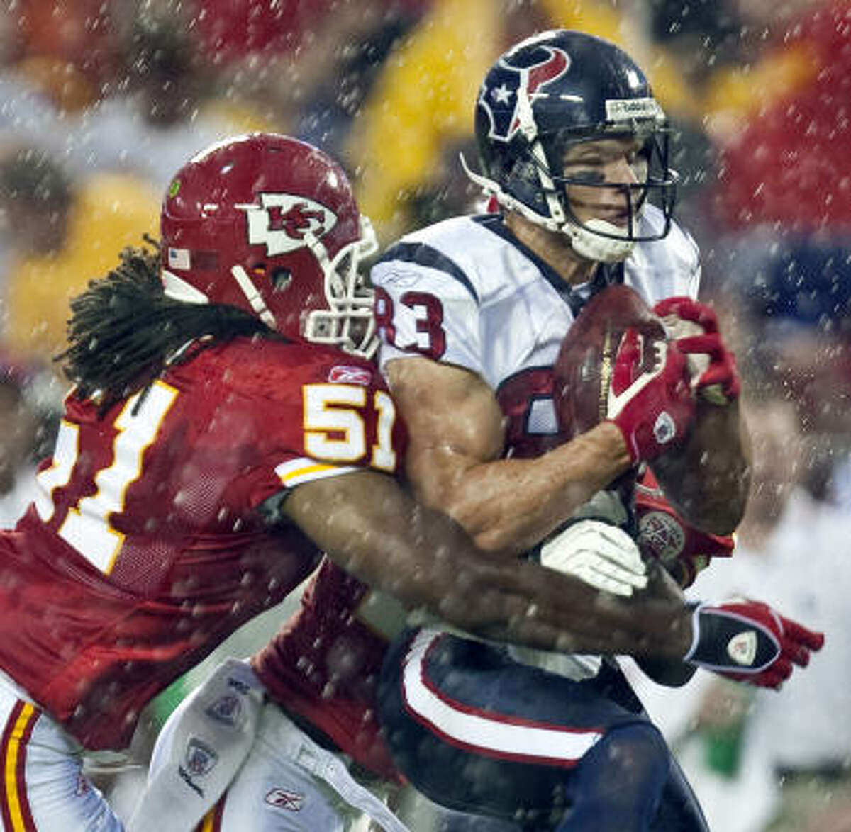 Chiefs linebacker Corey Mays stops wide receiver Kevin Walter.