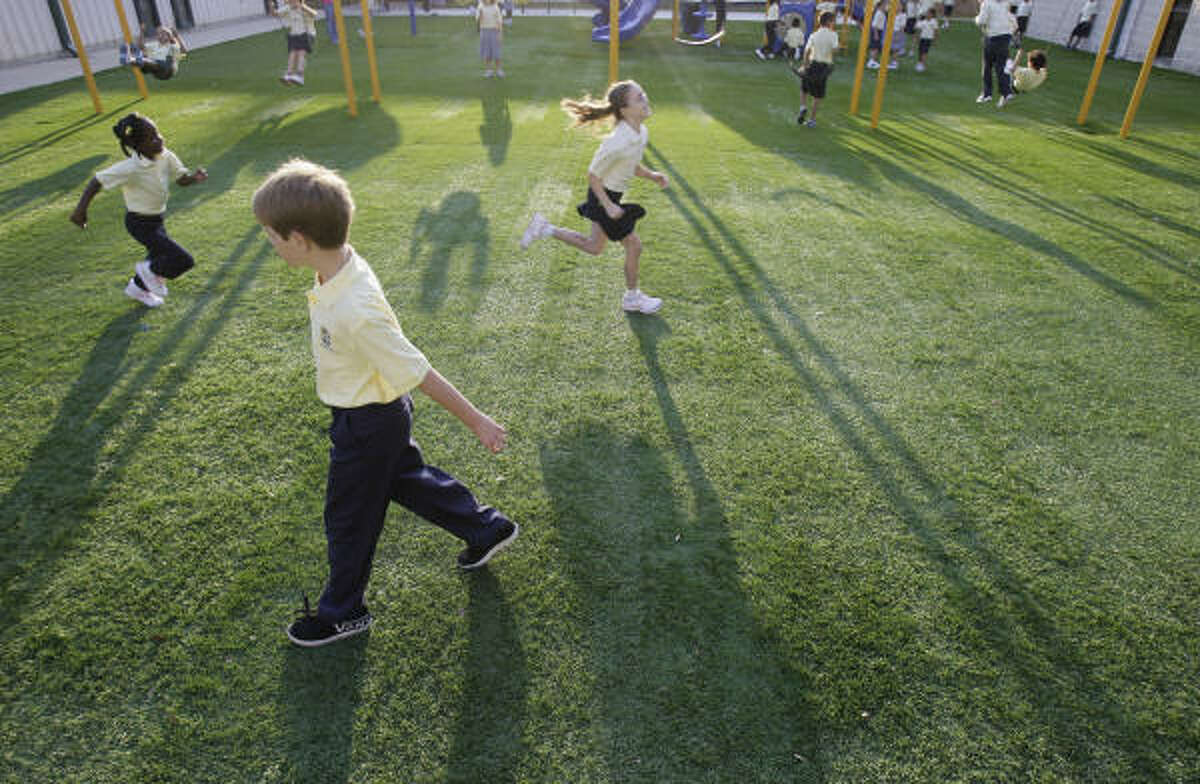 Children play before school starts on the first day of classes at Westbury Christian.