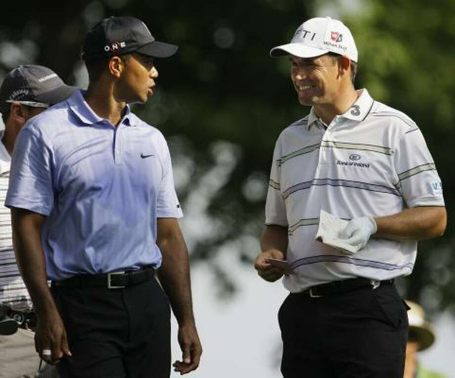 Tiger Woods, left, and Padraig Harrington chat on the tee box one week after going head-to-head in the final group at the Bridgestone. Photo: Charlie Riedel, AP