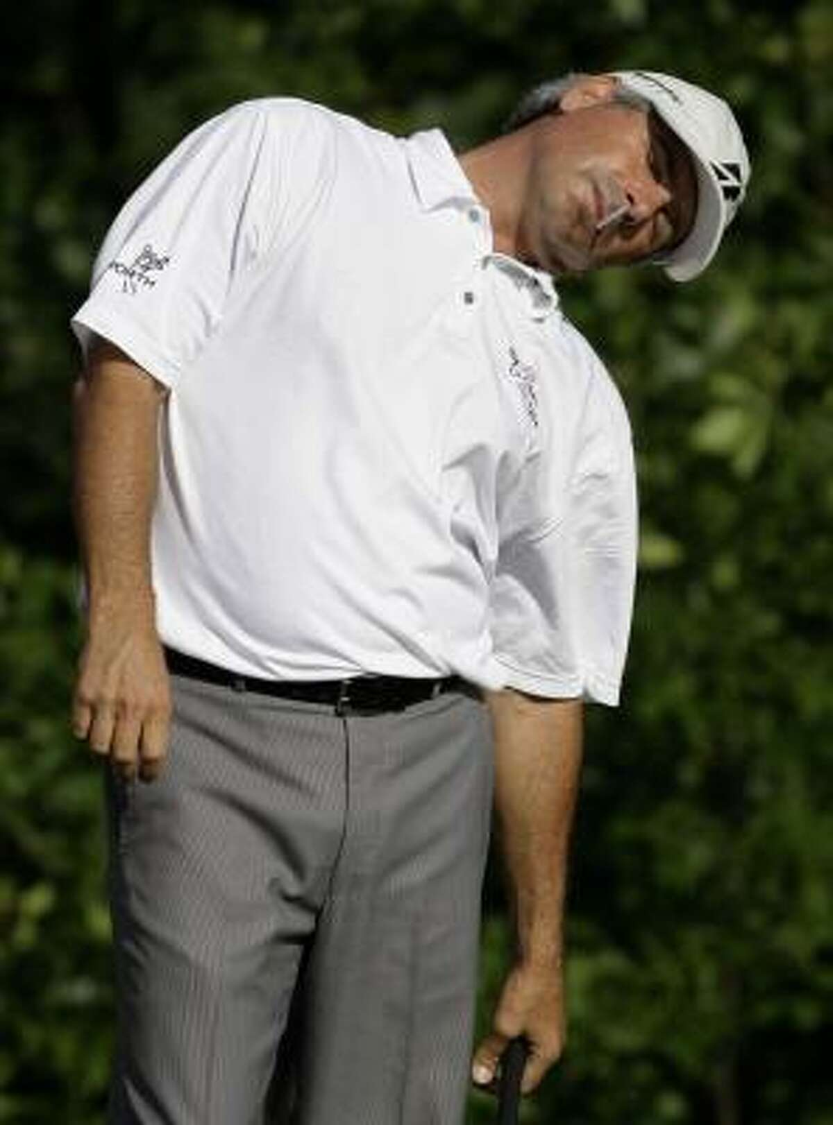 Fred Couples, a former UH Cougar, stretches out before teeing off from No. 10.