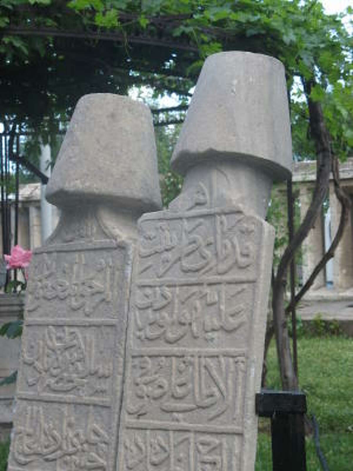 Headstones located in the grounds of the Mevlana museum are topped with conical shapes similar to the headdress the Dervishes wear to symbolize the ego's tomb.