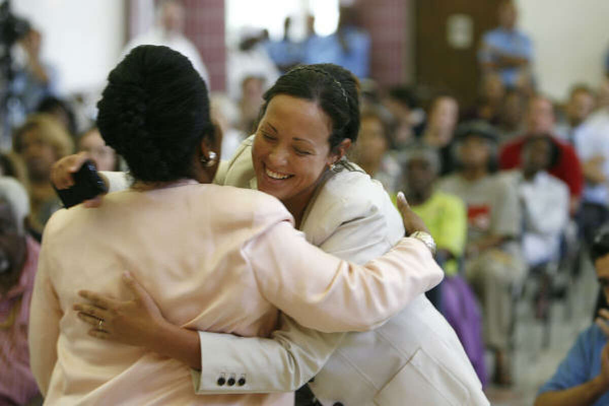 Sheila Jackson Lee hugs Roxana Mayer at her town hall meeting at Peavy Neighborhood Center. Mayer identified herself as a physician who does not live in Jackson Lee's district. However, her name does not appear in the database maintained by the Texas Medical Board, which licenses all doctors in Texas