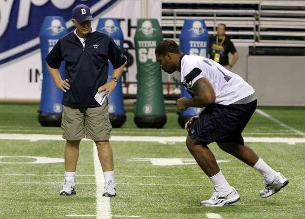 Tackle Tyron Smith (from) receives extra attention from offensive line coach Hudson Houck at the end of the morning session of the Dallas Cowboys training camp at the Alamodome on Saturday, Aug. 6, 2011. Kin Man Hui/kmhui@express-news.net Photo: KIN MAN HUI, -- / SAN ANTONIO EXPRESS-NEWS