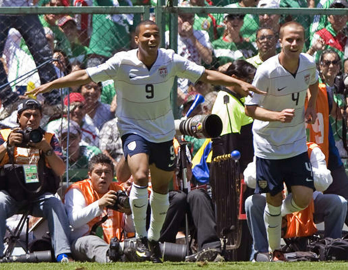 Charlie Davies, left, celebrates the first goal of the match, which gave the United States a 1-0 lead.