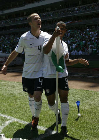 Charles Davies, right, and Michael Bradley of the U.S. celebrate after Davies scored against Mexico. Photo: Claudio Cruz, AP