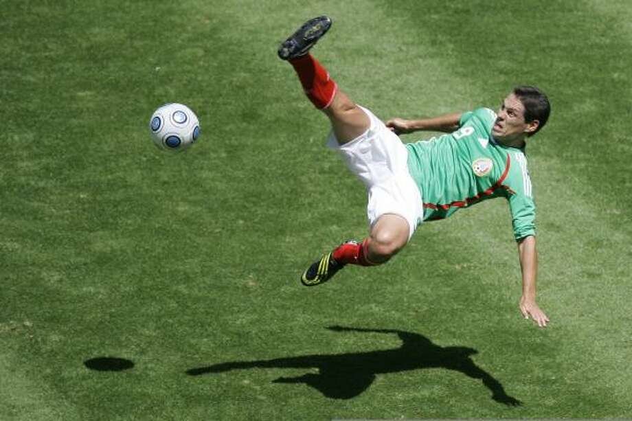 Mexico's Guillermo Franco goes up in the air for the ball. Photo: Miguel Tovar, AP