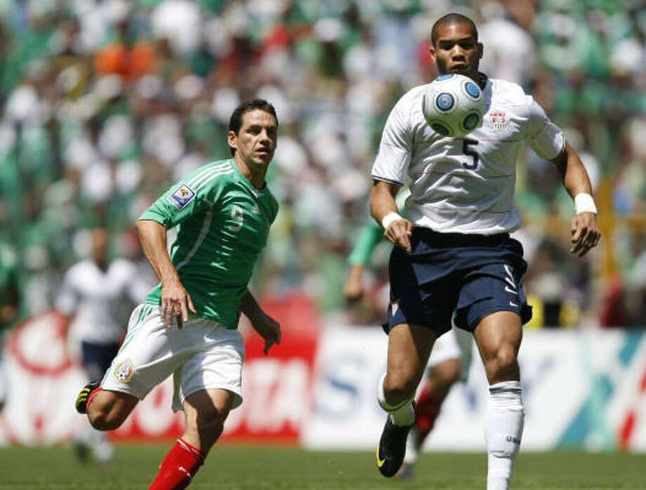 Oguchialu Onyewu, right, of the U.S. national soccer team, fights for the ball against Guillermo Franco of Mexico. Photo: Dario Lopez-Mills, AP