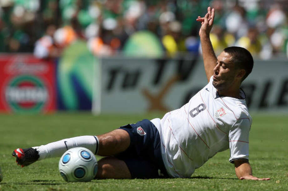U.S. forward Clint Dempsey slides for he ball during the secong half. Photo: Donald Miralle, Getty Images