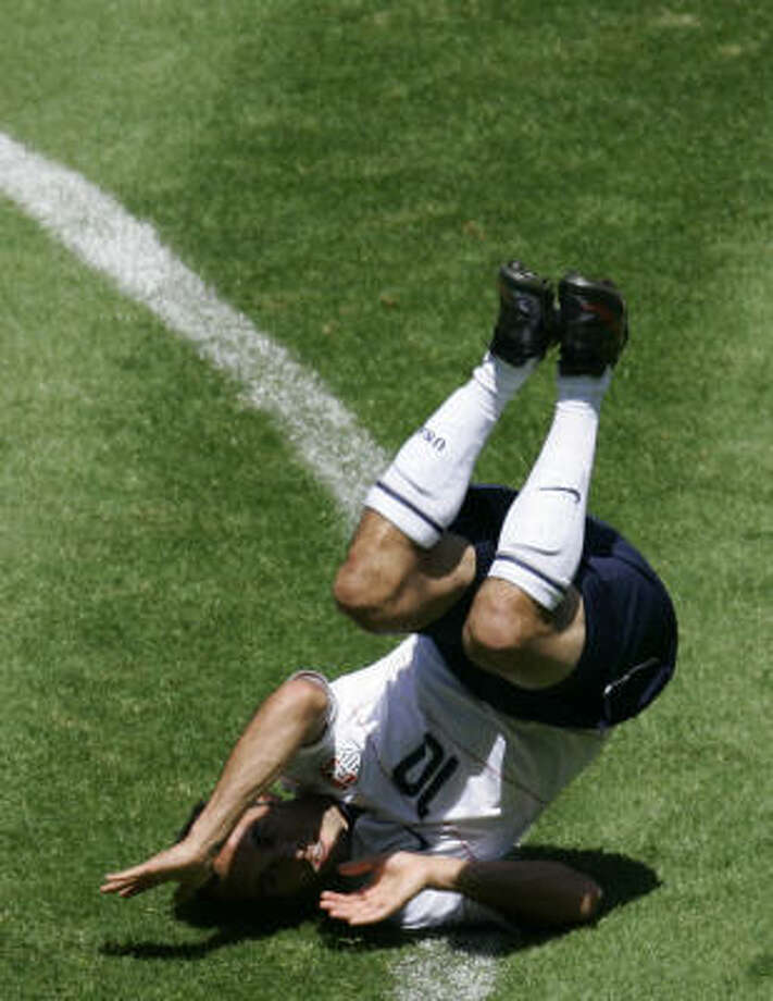 The U.S.'s  Landon Donovan lies on the ground injured during the second half. Photo: Miguel Tovar, AP