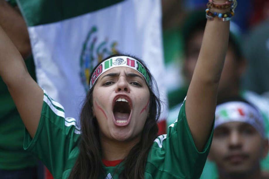 A Mexico soccer fan cheers for her team at Aztec Stadium in Mexico City. Photo: Dario Lopez-Mills, AP